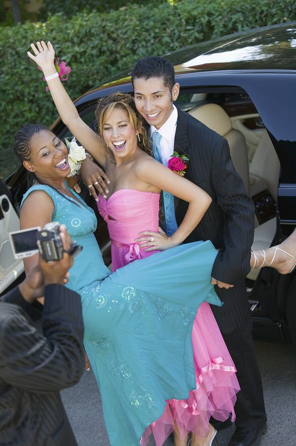Teenagers posing for pictures for prom
